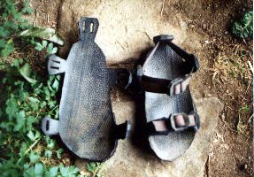 Tire sandal cut out and with straps.